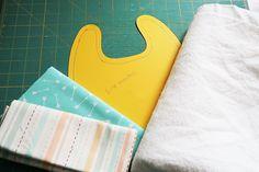 Baby Drool Bibs With FREE Pattern Sewing For Kids, Baby Sewing, Sewing Patterns Free, Free Pattern, Crib Sheet Tutorial, Drool Bibs, Fabric Scissors, Macrame Cord, Pom Pom Trim