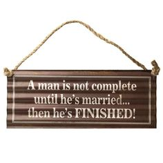 """Wedding/ stag sign """"Man is not complete until he's married."""""""