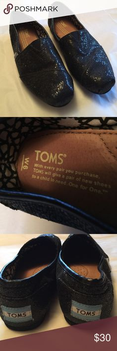 """Glittery Black Toms Excellent like new condition condition and open to all reasonable offers.  These are a size 9 M  Youth,  sole measures 9"""" from heel edge to toe edge TOMS Shoes"""