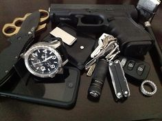 ZT 350 Brass knuckles Glock 19 Coach money clip wallet iPhone 5 Nixon watch Keys with Leatherman Squirt PS4 and Fenix E15 4Sevens Preon Tiff...