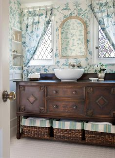 Love this sideboard that was made into a vanity. You will lose some of the storage in the drawers due to plumbing but put some cute baskets underneath and viola
