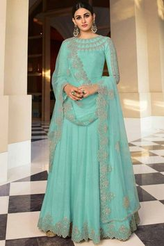 Perfectly cut, this aquamarine blue dupion silk anarkali suit which will give you absolute perfection. This round neck and full sleeve attire accentuated with stone and zari work. Set together with santoon/ lycra churidar in aquamarine blue color with aquamarine blue net dupatta. Churidar is plain. #anarkalisuit #usa #Indianwear #Indiandresses #andaazfashion Net Lehenga, Anarkali, Saree, Cotton Kaftan, Moroccan Caftan, Aqua Color, Salwar Kameez, Embroidery, Silk
