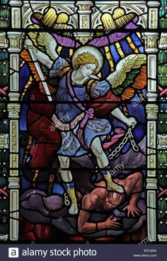 A Stained Glass Window Depicting Archangel Michael Slaying Satan Stock Photo, Royalty Free Image: 32229270 - Alamy