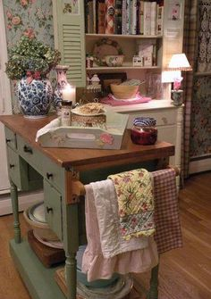 Kitchen island idea.  Desk on platform to make it workable counter height.