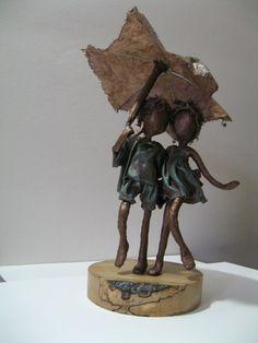 Rainy Days. Sculpture of Children with umbrella. Friendship