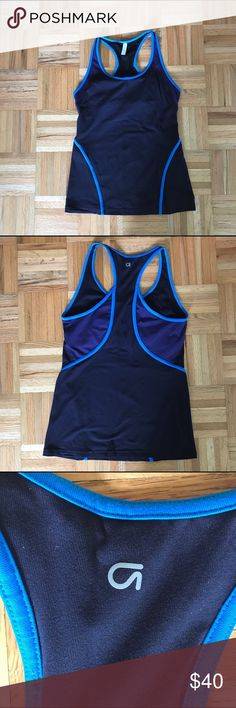 GapFit Racerback Shelf Tank GapFit Racerback Shelf Tank. Black and Purple with Turquoise Trim. Measures 25 inches from shoulder to bottom hem. Great for a long torso! Worn once - too long for me. GAP Tops Tank Tops