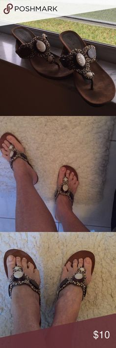 Rialto Wedge Sandals Cute pair of Rialto sandals adorned with beads, wood, gem-like plastic. Small scratch on right heel that can be touched up quite nicely. Doesn't really show when on. EUC Rialto Shoes Sandals