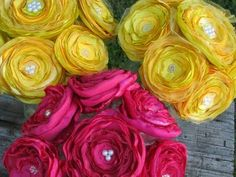 How about handmade fabric flowers? I've done this before...they are really cute