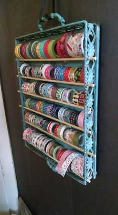 How to make a simple rope plant hanger hobbys easy and pretty washi tape storage metal tray from hobby lobby wooden dowels from walmart hung from a ribbon craft room makeover Craft Room Storage, Sewing Room Storage, Sewing Room Organization, Sewing Rooms, Knitting Storage, Craft Rooms, Craft Ribbon Storage, Bobbin Storage, Sewing Room Decor