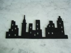 The city silhouette on Black Felt by kutz on Etsy, $7.50
