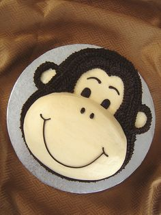 A monkey birthday cake is a fun treat to make for any child or adult who loves animals. No matter what level of decorating skill you have, you can create a . Monkey Birthday Cakes, Monkey Birthday Parties, Baby Birthday, Monkey Cakes, Birthday Ideas, Zoo Cake, Jungle Cake, Jungle Party, Cake Shapes