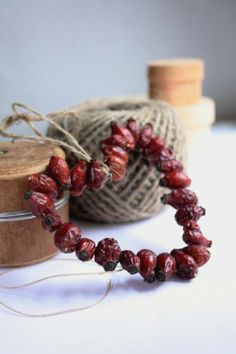 string dried cranberries on thin wire, bend into shapes (hearts, stars, wreaths) and hang with jute string.