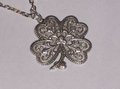 antiqued four leaf clover necklace