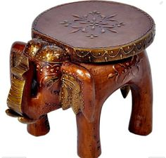 Designer Wooden Elephant Stool made of mango wood. Pretty and practical, this piece is made using solid reclaimed wood.