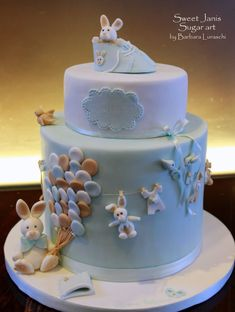 I made this cake for the christening of little Edoardo. Vanilla cake filled with white chocolate ganache and raspberries. Sugar paste decorations handmade
