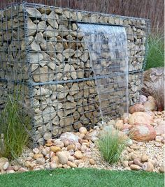 gabion wall design ideas garden water feature waterfall garden decorating ideas Have you ever wondered how you can incorporate a gabion into your interior We have a colle. Modern Landscaping, Backyard Landscaping, Gabion Wall Design, Gabion Retaining Wall, Gabion Stone, Landscape Design, Garden Design, Gabion Baskets, Pot Jardin
