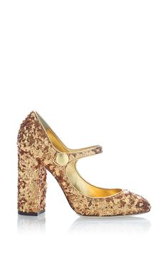 This **Dolce & Gabbana** pump is rendered in sequins and features a Mary jane strap.