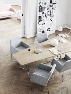 conference room... chevron floors, comfy grey chairs, group inspiration board