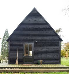 Belgian lakeside cabin with black cladding by De Rosee Sa Architects London | Remodelista