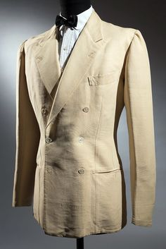 SHARP LINEN BLAZER ...Great and cool for Summer; take caution in setting it off with either a bow tie or regular tie based on your face and torso ...