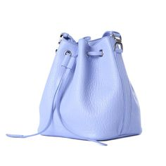 The Rochas Lilac Bucket Bag is a small bucket bag. Made of lamb skin leather it features a textured soft leather and silver hardware.