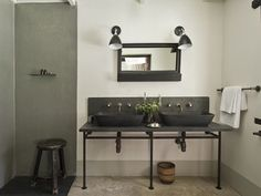 industrial rustic bathroom, gray stone pendestal sink, salvaged funrniture, black, white, and gray, Satyagraha House