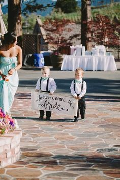"""In lieu of ring bearers, carry """"here comes the bride"""" sign on burlap and wood bar.  Photography: Amie Soares"""