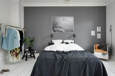 Bedroom with a grey wall