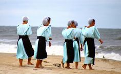 Amish women by the ocean