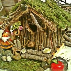 Bird house.twigs.moss roll.river rocks.hot glue= gnomie house!!