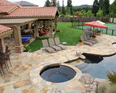 Natural flagstone wraps this landscape in warmth, from the pool deck to the living areas under the cabana and loggia. Big Pools, Rock Pools, Outdoor Rooms, Outdoor Living, Outdoor Decor, Outdoor Furniture, Small Gazebo, Warm And Cool Colors, Dream Pools