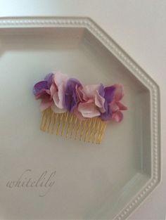 パステルカラーのアートフラワーの紫陽花で製作したコームです♡色合いも春らしくてとっても可愛いお品です♡♡♡華やかな席にオススメのお品です✴︎✴︎✴︎☆ご購入の...|ハンドメイド、手作り、手仕事品の通販・販売・購入ならCreema。