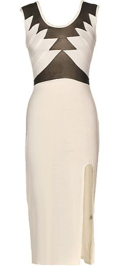Battle Born Dress: Features a seductive black mesh bodice with symmetrical white wings covering the bust, sexy scoop design to the rear, thigh-high slit to the left, and a demure calf-grazing hem to finish.