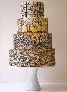 Now picture a stained glass cake that looked like a peacock tiffany lamp in theme and color.  That would be awesome.