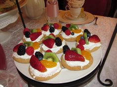 Individual Fruit Pizza. Buy sugar cookies from the bakery. Combine Cool Whip, Softened Cream Cheese, Powdered Sugar, & Vanilla for the Frosting. Add fresh, colorful fruit. Enjoy!