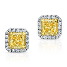 18K WHITE AND YELLOW GOLD INSPIRED STUD EARRINGS FEATURING TWO NATURAL FANCY YELLOW RADIANT TOTALING 2.06 CARAT AND SURROUNDED BY ROUND WHITE DIAMONDS