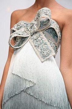 Detail. Tiered tassel cocktail gown.