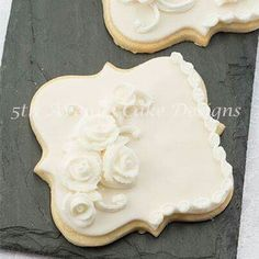 Bobbi Noto, 5th Ave Cake Designs:  White on white English over piped cookies.