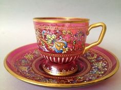 Cranberry glass hand enamelled and gilt cup and saucer set by Moser, 19th Cent.