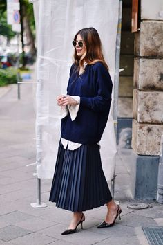 Pleated skirt, button up shirt, smaller more tailored pullover