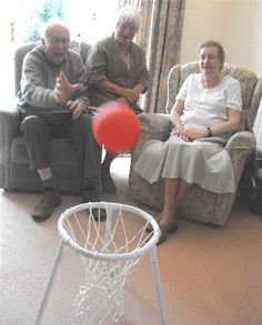 Basketball for residents with Dementia. Sit residents in a circle with the basket in the center. Have residents take turns tossing the ball. Laundry baskets work well too!