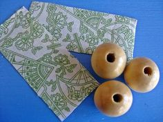 Covering wooden beads with fabric
