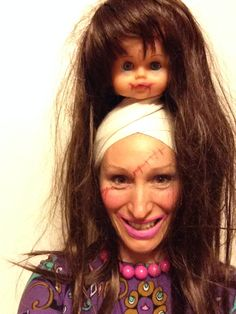DIY Halloween costume made with a used dolls head - A successful 'I want more brains operation'....