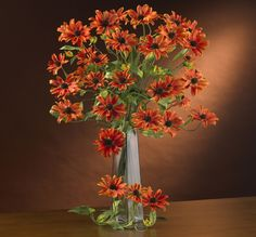 What an interesting flower we have here: the cosmos stem is appealing to the eye for several reasons. First, it has interesting steams that curve and branch in a spider-like manner. Then, these stems are adorned with leafy greens at $64.99   http://www.bboescape.com/products/buy/183/say-it-with-flowers/-Cosmo-Stem-Set-of-