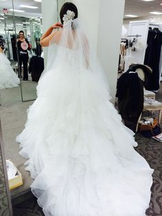 """This beautiful dress was purchased new in 2014.. It is champagne color and a size 4.. However, this dress has been modified and is closer to a size 2. I am 5' 1"""" and the dress has been modified to fit my stature but also has a professionally made hem in the American style. I've worn the dress only inside the store of purchase and when fitted, a total of 2 times. It is currently preserved in a box ready to go. The dress still has the tags on. I hope this can be your dream dress as it was"""