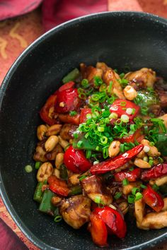 Moist tender chunks of rice wine marinated chicken with peppers and bronzed peanuts glazed with a piquant sauce that's redolent of citrusy Sichuan peppers.