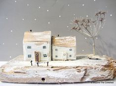 A Winters Tale Snowy whitewashed cottages with frosty winter tree Handmade from Cornish driftwood 18 cm long x 7 cm wide x 11 cm high Please note the little tree will be packed separately for posting to keep it safe Painted Driftwood, Driftwood Crafts, Wooden Crafts, Recycled Crafts, Wooden Cottage, Wooden Houses, Tiny Little Houses, Small Houses, Wooden Christmas Decorations