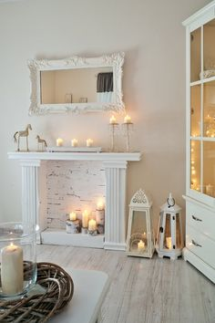 The perfect faux fireplace in white with brick, candles and a beautiful mirror to finish it off