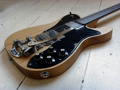 Holy Schnikes.  I love this guitar with my whole soul.  Built by The Creamery in Manchester, UK.