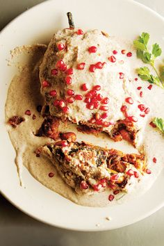 Chiles en Nogada (Stuffed Poblano Chiles with Walnut Sauce)  Traditionally made in Puebla to celebrate Mexican Independence Day on September 16, these chiles have a minced pork filling enhanced with chopped fruit, and a creamy walnut sauce.